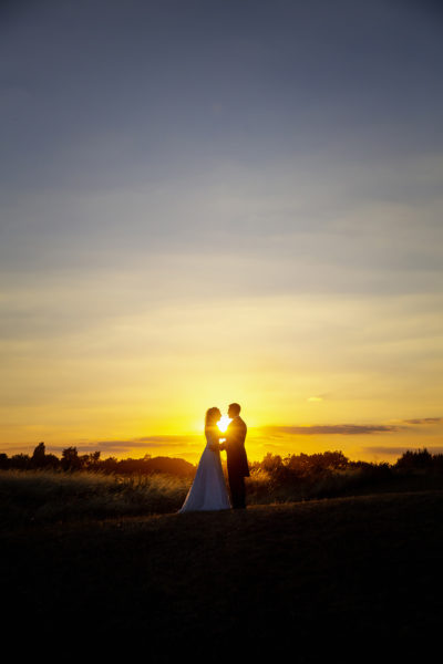 Romantic sunset wedding photo